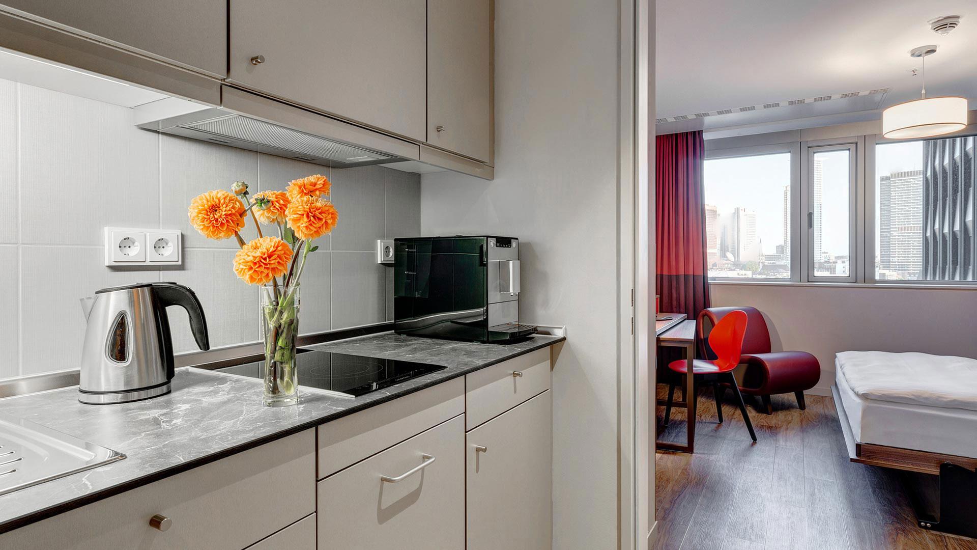 Foto einer Zimmeransicht - 01 - Aparthotel Frankfurt City
